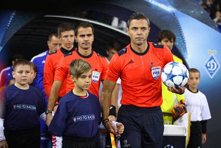 jure: KYIV, UKRAINE - OCTOBER 20, 2015: Referee Damir Skomina of Slovenia and his assistants go to the pitch of NSC Olimpiyskyi stadium before UEFA Champions League game FC Dynamo Kyiv vs Chelsea