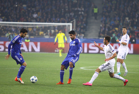 cesc: KYIV, UKRAINE - OCTOBER 20, 2015: FC Dynamo Kyiv players in white fight for a ball with Chelsea players Blue during their UEFA Champions League game at NSC Olimpiyskyi stadium in Kyiv Editorial