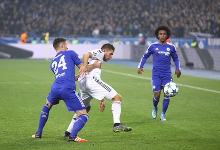 cahill: KYIV, UKRAINE - OCTOBER 20, 2015: Artem Kravets of Dynamo Kyiv C fights for a ball with Gary Cahill and Willian of Chelsea during their UEFA Champions League game at NSC Olimpiyskyi stadium in Kyiv