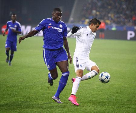 KYIV, UKRAINE - OCTOBER 20, 2015: Derlis Gonzalez of Dynamo Kyiv R fights for a ball with Kurt Zouma of Chelsea during their UEFA Champions League game at NSC Olimpiyskyi stadium in Kyiv