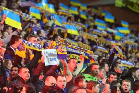 LVIV, UKRAINE - NOVEMBER 14, 2015: Ukrainian supporters show their support during UEFA EURO 2016 Play-off for Final Tournament game between Ukraine and Slovenia at Lviv Arena