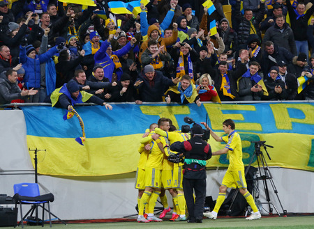 react: LVIV, UKRAINE - NOVEMBER 14, 2015: Ukrainian footballers react after scored a goal during UEFA EURO 2016 Play-off for Final Tournament game against Slovenia at Lviv Arena