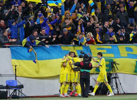 scored: LVIV, UKRAINE - NOVEMBER 14, 2015: Ukrainian footballers react after scored a goal during UEFA EURO 2016 Play-off for Final Tournament game against Slovenia at Lviv Arena