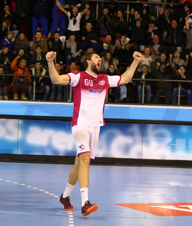 reacts: KYIV, UKRAINE - NOVEMBER 28, 2015: Sergii Burka of Motor reacts after scored a goal during VELUX EHF Champions League 201516 Handball game against Kadetten Schaffhausen