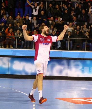 burka: KYIV, UKRAINE - NOVEMBER 28, 2015: Sergii Burka of Motor reacts after scored a goal during VELUX EHF Champions League 201516 Handball game against Kadetten Schaffhausen