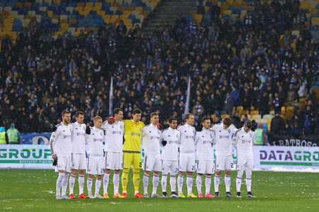 KYIV, UKRAINE - NOVEMBER 29, 2015: Minute of silence to pay tribute to victims of Soviet famine of 193233 during Ukrainian Premier League game FC Dynamo Kyiv vs FC Chornomorets Odesa
