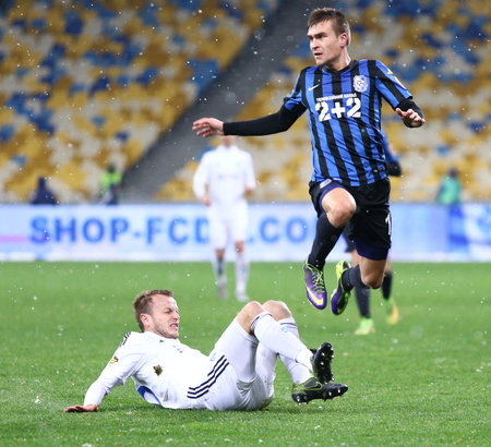 gusev: KYIV, UKRAINE - NOVEMBER 29, 2015: Oleh Gusev of Dynamo Kyiv L fights for a ball with Oleksandr Kalitov of FC Chornomorets Odesa during their Ukrainian Premier League game