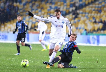 premier league: KYIV, UKRAINE - NOVEMBER 29, 2015: Radosav Petrovic of Dynamo Kyiv L fights for a ball with Artem Filimonov of FC Chornomorets Odesa during their Ukrainian Premier League game