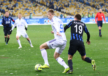 olimpiysky: KYIV, UKRAINE - NOVEMBER 29, 2015: Lukasz Teodorczyk of Dynamo Kyiv in White fights for a ball with Oleksandr Kalitov of FC Chornomorets Odesa during their Ukrainian Premier League game Editorial
