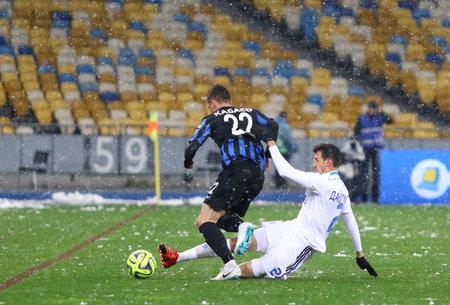 dynamo: KYIV, UKRAINE - NOVEMBER 29, 2015: Danilo Silva of Dynamo Kyiv R fights for a ball with Vladislav Kabaev of FC Chornomorets Odesa during their Ukrainian Premier League game