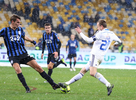 premier: KYIV, UKRAINE - NOVEMBER 29, 2015: Oleh Gusev of Dynamo Kyiv R fights for a ball with Yevhen Martynenko of FC Chornomorets Odesa during their Ukrainian Premier League game at NSC Olimpiyskyi stadium