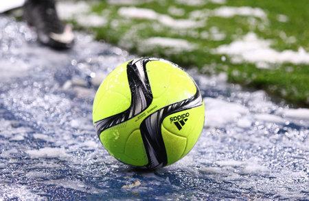 adidas: KYIV, UKRAINE - NOVEMBER 29, 2015: Close-up Ukrainian Premier League 201516 season ball Adidas CoNext15 on the grass during the game between FC Dynamo Kyiv and FC Chornomorets Odesa