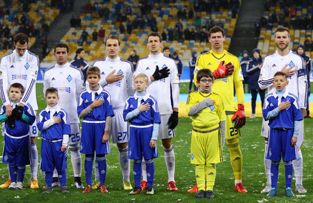 anthem: KYIV, UKRAINE - NOVEMBER 29, 2015: FC Dynamo Kyiv players listen to National Anthem of Ukraine before Ukrainian Premier League game against FC Chornomorets Odesa at NSC Olimpiyskyi stadium Editorial