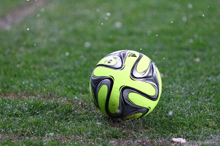 adidas: KYIV, UKRAINE - NOVEMBER 29, 2015: Close-up Ukrainian Premier League 201516 season ball Adidas CoNext15 on the grass during the game between FC Dynamo Kyiv and FC Chornomorets Odesa