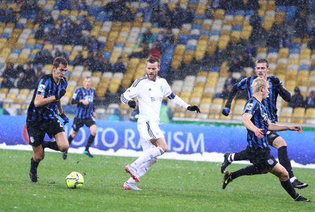 premier: KYIV, UKRAINE - NOVEMBER 29, 2015: Andriy Yarmolenko of Dynamo Kyiv in White fights for a ball with FC Chornomorets Odesa players during their Ukrainian Premier League game Editorial