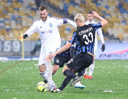dynamo: KYIV, UKRAINE - NOVEMBER 29, 2015: Andriy Yarmolenko of Dynamo Kyiv L fights for a ball with Andriy Slinkin of FC Chornomorets Odesa during their Ukrainian Premier League game