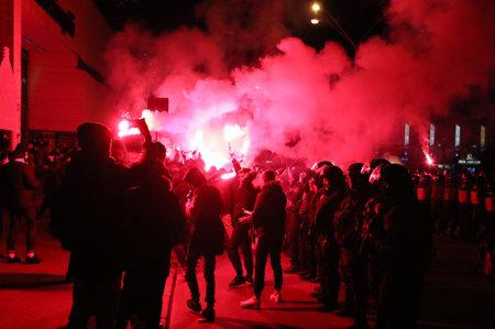 ultras: KYIV, UKRAINE - DECEMBER 9, 2015: FC Dynamo Kyiv ultras support their team on the road to NSC Olimpiyskyi stadium before UEFA Champions League game against Maccabi Tel-Aviv Editorial