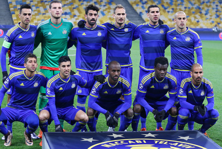 KYIV, UKRAINE - DECEMBER 9, 2015: Maccabi Tel-Aviv players pose for a group photo before UEFA Champions League game against FC Dynamo Kyiv at NSC Olimpiyskyi stadium in Kyiv