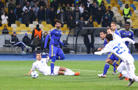 9 ball: KYIV, UKRAINE - DECEMBER 9, 2015: FC Dynamo Kyiv players in white fight for a ball with Maccabi Tel-Aviv players Blue during their UEFA Champions League game at NSC Olimpiyskyi stadium in Kyiv Editorial