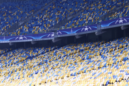 KYIV, UKRAINE - DECEMBER 9, 2015: Empty tribunes of NSC Olimpiyskyi stadium during UEFA Champions League game FC Dynamo Kyiv vs Maccabi Tel-Aviv. Uefa punished FC Dynamo Kyiv with game stadium ban