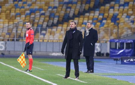 KYIV, UKRAINE - DECEMBER 9, 2015: FC Dynamo Kyiv manager Serhiy Rebrov C looks on during UEFA Champions League game against FC Dynamo Kyiv at NSC Olimpiyskyi stadium in Kyiv Editorial