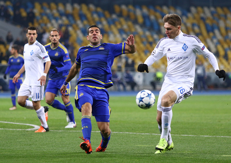 9 ball: KYIV, UKRAINE - DECEMBER 9, 2015: Serhiy Sydorchuk of Dynamo Kyiv R fights for a ball with Eytan Tibi of Maccabi Tel-Aviv during their UEFA Champions League game at NSC Olimpiyskyi stadium in Kyiv