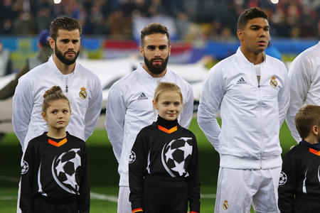 anthem: LVIV, UKRAINE - NOVEMBER 25, 2015: Real Madrid players listen official anthem before UEFA Champions League game against FC Shakhtar Donetsk at Arena Lviv stadium