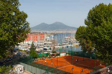 Napoli: NAPLES, ITALY - MAY 6, 2015: Tennis courts of Circolo Canottieri Napoli club in center of Naples city, Italy. Mount Vesuvius and Gulf of Napoli on the background