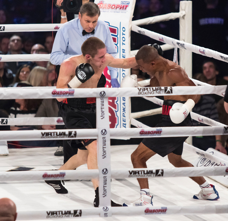 silva: KYIV, UKRAINE - DECEMBER 12, 2015: Oleg Malinovskiy of Ukraine L fights with Aldimar Silva Santos of Brazil during Evening of Boxing in the Palace of Sports in Kyiv Editorial