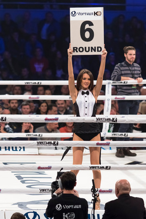 round: KYIV, UKRAINE - DECEMBER 12, 2015: Boxing ring girls holding a board with round number during WBO Intercontinental cruiserweight Title fight Oleksandr Usyk vs Pedro Rodriguez at Palace of Sports