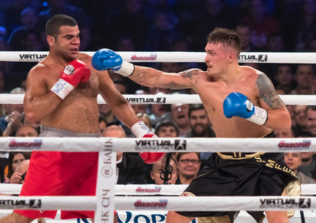 intercontinental: KYIV, UKRAINE - DECEMBER 12, 2015: Oleksandr Usyk of Ukraine black shorts and Pedro Rodriguez of Cuba in the ring during fight for WBO Intercontinental Cruiserweight Title in the Palace of Sports