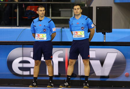 referees: KYIV, UKRAINE - NOVEMBER 28, 2015: Referees Georgios Panayides L and Marios Andreou both from Cyprus look on during VELUX EHF Champions League 201516 Handball game Motor vs Kadetten Schaffhausen