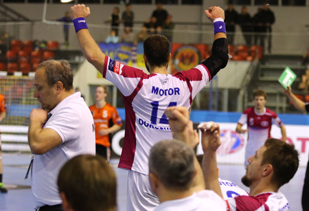 react: KYIV, UKRAINE - NOVEMBER 28, 2015: HC Motor players react after scored a goal during VELUX EHF Champions League 201516 game against Kadetten Schaffhausen