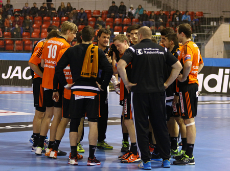 timeout: KYIV, UKRAINE - NOVEMBER 28, 2015: Time-out of Kadetten Schaffhausen handball team during VELUX EHF Champions League 201516 game against Motor