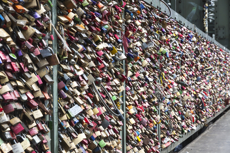unbreakable: COLOGNE, GERMANY - APRIL 30, 2013: Hohenzollern Bridge with thousands of personal love padlocks, which have been places here since 2008. It is the most heavily used railway bridge in Germany