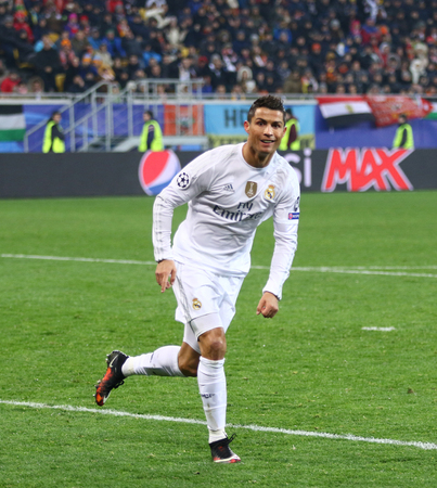 reacts: LVIV, UKRAINE - NOVEMBER 25, 2015: Cristiano Ronaldo of Real Madrid reacts after scored a goal during UEFA Champions League game against FC Shakhtar Donetsk at Arena Lviv stadium