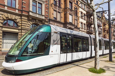 STRASBOURG, FRANCE - MAY 6, 2013: Modern tram model Alstom Citadis 403 on a street of Strasbourg, Alsace region, France. Current tramway network has 6 lines with a total route length of 40.7 km Editorial