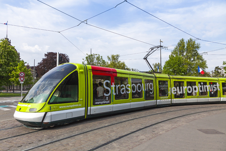 STRASBOURG, FRANCE - MAY 6, 2013: Modern tram model Eurotram on a street of Strasbourg, Alsace region, France. Current tramway network has 6 lines with a total route length of 40.7 km
