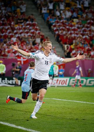 scored: LVIV, UKRAINE - JUNE 17: Lars Bender of Germany reacts after scored a goal against Denmark during their UEFA EURO 2012 game on Lviv Arena Editorial