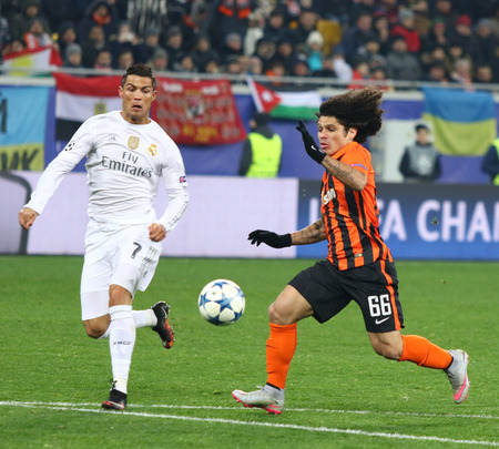 LVIV, UKRAINE - NOVEMBER 25, 2015: Cristiano Ronaldo of Real Madrid L fights for a ball with Marcio Azevedo of Shakhtar Donetsk during their UEFA Champions League game at Arena Lviv stadium Editorial