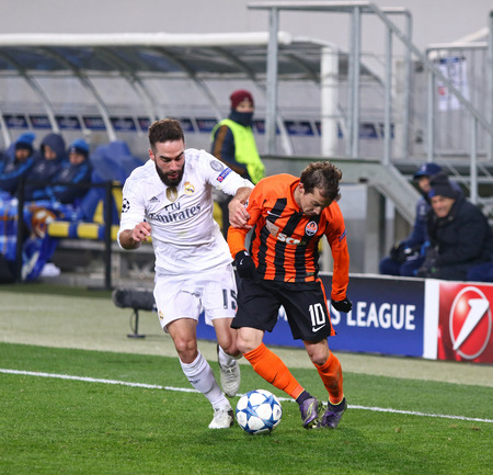 dani: LVIV, UKRAINE - NOVEMBER 25, 2015: Bernard of Shakhtar Donetsk R fights for a ball with Dani Carvajal of Real Madrid during their UEFA Champions League game at Arena Lviv stadium Editorial