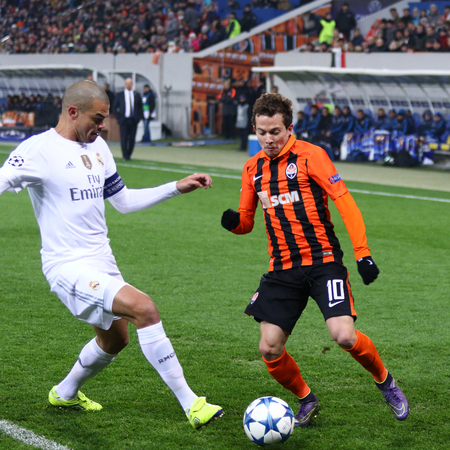 pepe: LVIV, UKRAINE - NOVEMBER 25, 2015: Bernard of Shakhtar Donetsk R fights for a ball with Pepe of Real Madrid during their UEFA Champions League game at Arena Lviv stadium Editorial