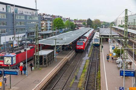freiburg: FREIBURG im BREISGAU, GERMANY - MAY 2, 2013: Freiburg Hauptbahnhof railway station. The main railway station of German city Freiburg im Breisgau with 250 daily trains and near 60000 daily visitors