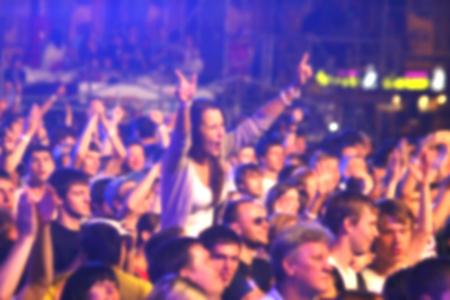 unrecognizable people: Blurred unrecognizable people dance during rock concert