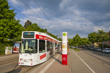 freiburg: FREIBURG IM BREISGAU, GERMANY - MAY 5, 2013: Tram in downtown of Freiburg im Breisgau, Baden-wurttemberg state, Germany. Freiburg tram network has 5 lines, serves 68 stops