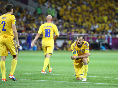 react: KYIV, UKRAINE - JUNE 11, 2012: Players of Ukraine National team react after missed a goal during UEFA EURO 2012 game against Sweden at Olympic stadium in Kyiv