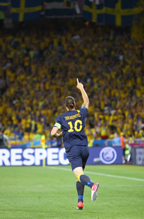 reacts: KYIV, UKRAINE - JUNE 11, 2012: Zlatan Ibrahimovic of Sweden reacts after score against Ukraine during their UEFA EURO 2012 game at Olympic stadium in Kyiv