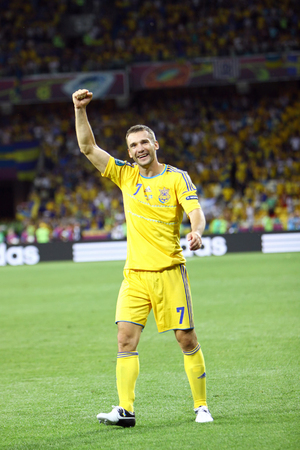 winning pitch: KYIV, UKRAINE - JUNE 11, 2012: Andriy Shevchenko of Ukraine reacts after score against Sweden during their UEFA EURO 2012 game at Olympic stadium in Kyiv Editorial