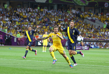 KYIV, UKRAINE - JUNE 11, 2012: Andriy Voronin of Ukraine C fights for a ball with Andreas Granqvist of Sweden during their UEFA EURO 2012 game at Olympic stadium in Kyiv Editorial