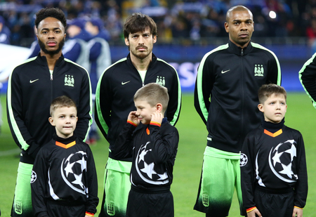 KYIV, UKRAINE - FEBRUARY 24, 2016: FC Manchester City players Raheem Sterling, David Silva and Fernandinho listen official anthem before UEFA Champions League match against FC Dynamo Kyiv